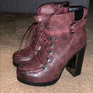 Oxblood lace up combat boot.